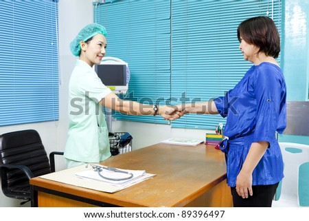 Female Doctor and Female Patient - stock photo