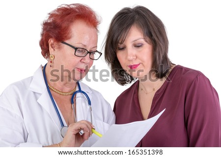 Female Doctor and her female patient discussing exam results, might be the payment options - stock photo