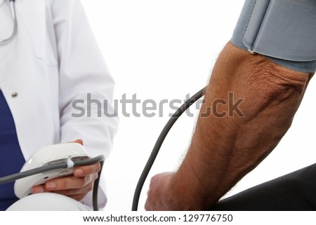 Female doctor and older man - pressure gauge - stock photo