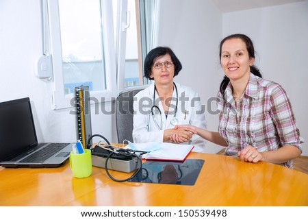 Female Doctor and patient - stock photo