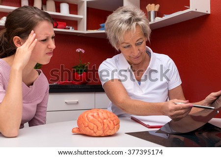 female doctor and patient talking about headaches or migraine, in a surgery