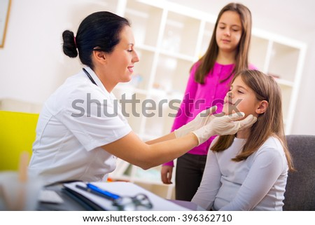 Female doctor and patient teenagers.Medical examination. Selective focus - stock photo