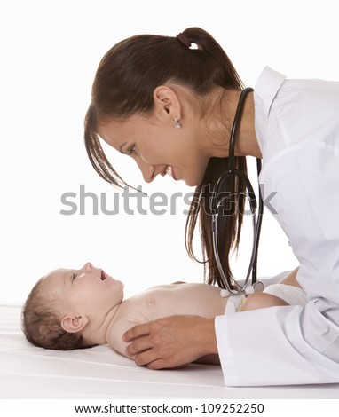 female doctor checking baby on white isolated background - stock photo