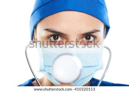 female doctor close up with stethoscope and mask