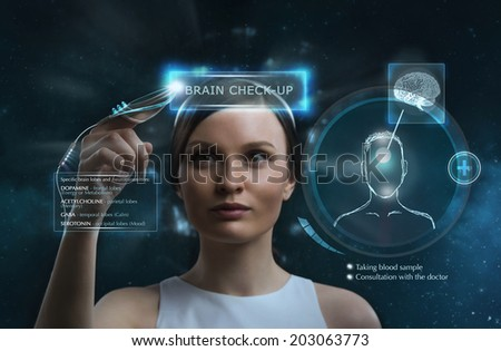 Female doctor doing checkup of human brain using futuristic computer technology