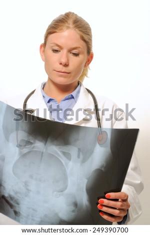 Female doctor examining an x-ray image - stock photo