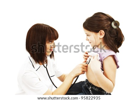 Female doctor examining child with stethoscope at surgery. Isolated on white background.