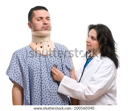 Female doctor examining patient suffering neck ache