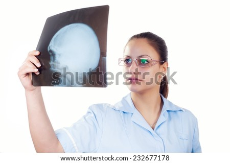 Female doctor examining x-ray image of the patients skull isolated on white background. - stock photo