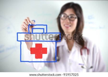 female doctor, female doctor drawing first aid bag graphic. - stock photo