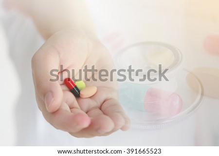 female doctor hand holding medicine pills