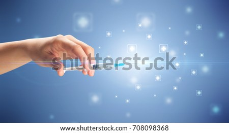 Female doctor hand holding syringe with shiny crosses in the background
