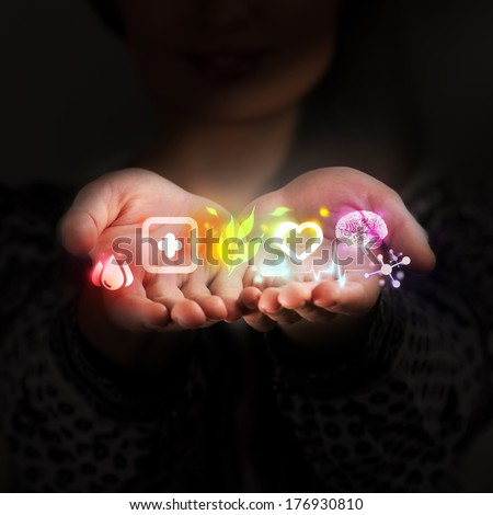Female doctor hand holds virtual medical icons as medical concept - stock photo
