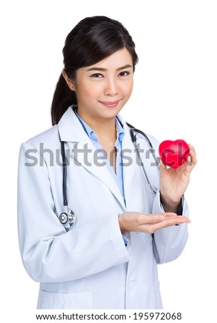 Female doctor hodling heart shape squeezing ball - stock photo
