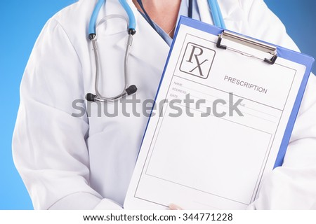 female doctor holding a clipboard with prescription