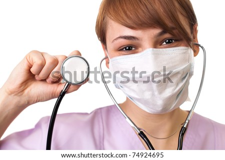 Female doctor holding stethoscope pointed toward camera