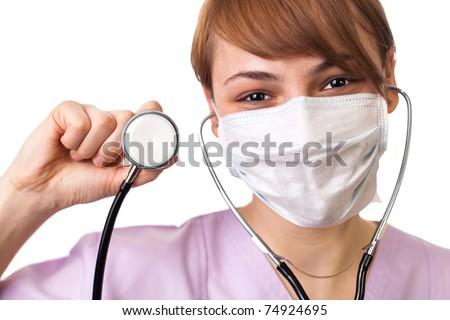 Female doctor holding stethoscope pointed toward camera - stock photo