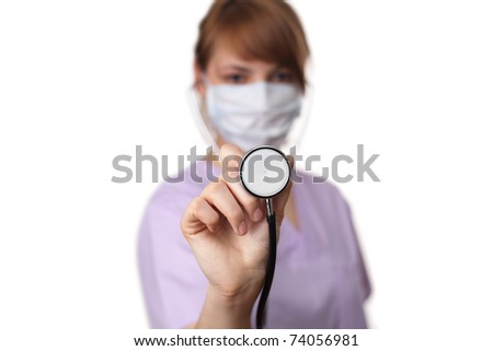 Female doctor holding stethoscope pointed toward camera 5. selective focus