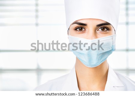 Female doctor in a mask