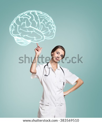 Female doctor in uniform touch painted brain - stock photo