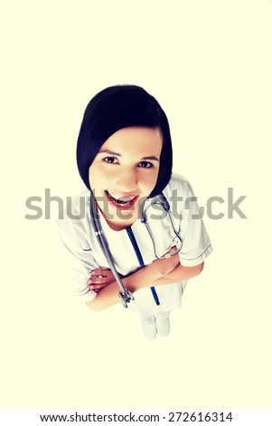 Female doctor in uniform wearing stethoscope - stock photo