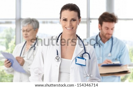 Female doctor leading medical professionals. - stock photo