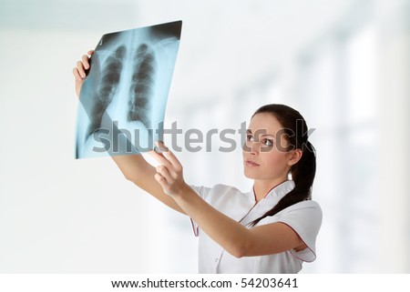 Female doctor looking at an x-ray - stock photo