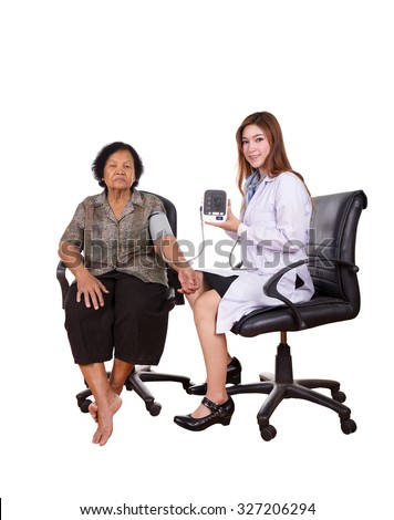 Female doctor measuring blood pressure of senior woman isolated on white background - stock photo