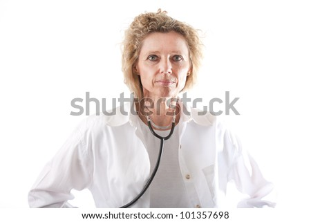 Female Doctor middle aged in uniform with stethoscope - stock photo