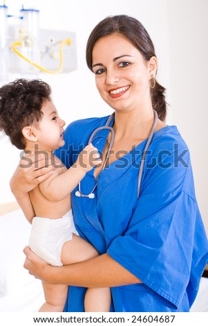 female doctor or nurse holding a baby boy - stock photo