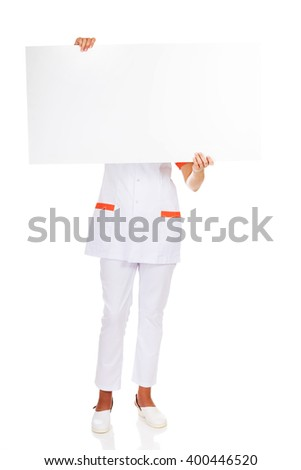 Female doctor or nurse  holding empty banner - stock photo