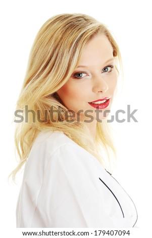 Female doctor or nurse, isolated on white  - stock photo
