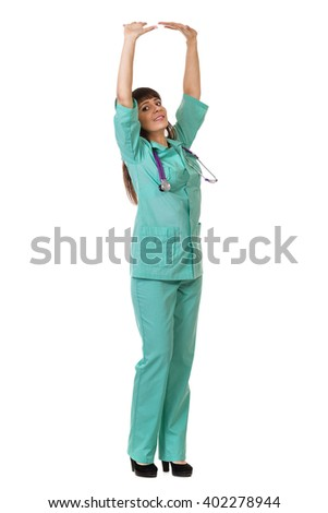 Female doctor  pushing or leaning on wall - stock photo