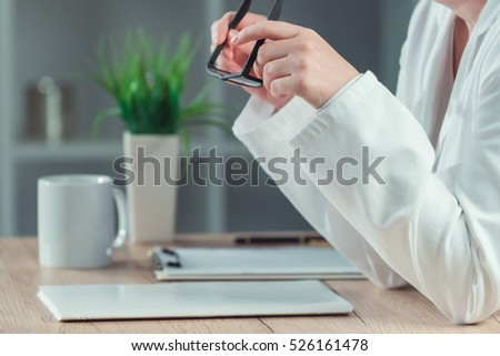 Female doctor reading patient medical history record in hospital office, healthcare and medicine professional at work