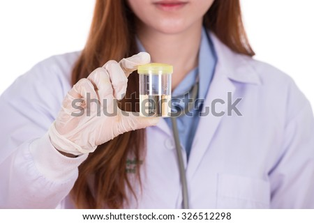 female doctor's hand holding a bottle of urine sample  - stock photo