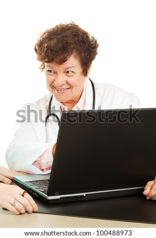 Female doctor showing a patient her test results on the computer.  Isolated on white.