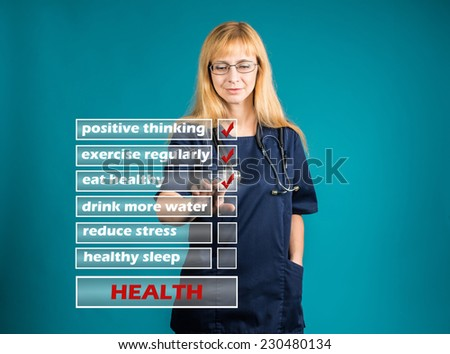 Female doctor showing presenting healthy lifestyle concept on visual screen on blue background. - stock photo