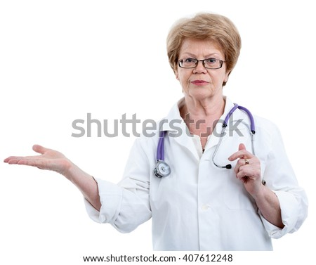 Female doctor showing with stretched arm, isolated on white background - stock photo