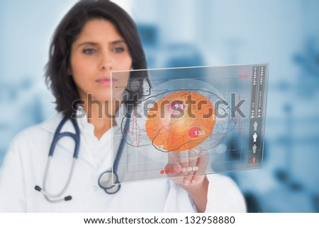 Female doctor touching a touchscreen in the hospital