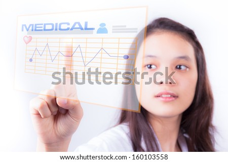Female doctor touching a touchscreen in the hospital - stock photo