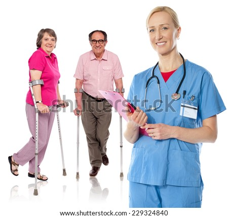 Female doctor with clipboard, mature patients standing behind - stock photo