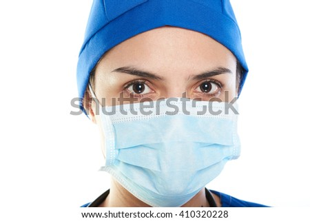 female doctor with mask close up on white background and blue uniform