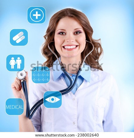 Female doctor with stethoscope and virtual screen - stock photo
