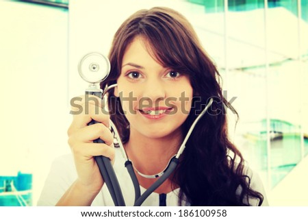 Female doctor with stethoscope - focus on stethoscope - stock photo