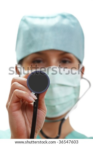 Female doctor with stethoscope.Selective focus on the stethoscope. - stock photo
