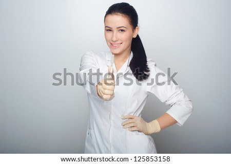 Female doctor with toothbrush