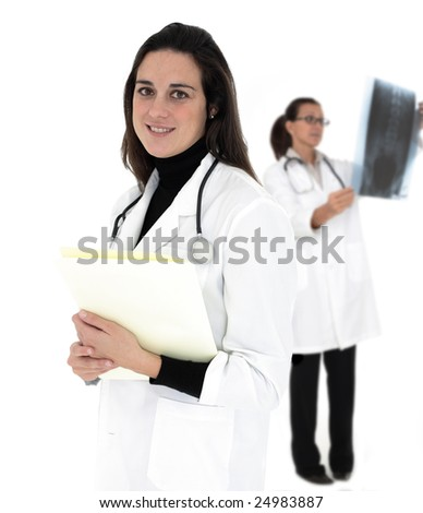 Female doctors. Examining x-ray record in the background.