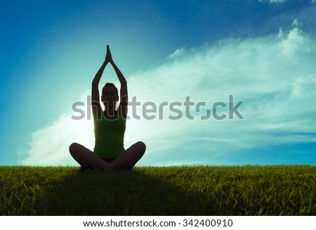 Female doing yoga. - stock photo