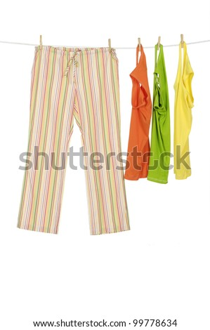 female dress shirt and trousers clothespins on rope - stock photo