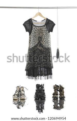 female dress with bag and shoes isolated on a hanger - stock photo